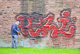 Picture of an Enviropest employee working on graffiti removal