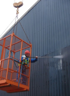 A picture of someone carrying out a jet wash for garffiti removal