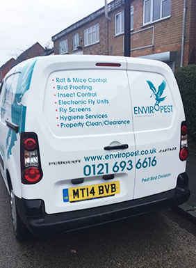 Image of an Enviropest Control Services Ltd van, taken from the back